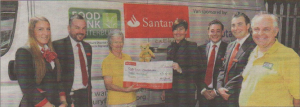 Santander hand over a cheque for £3,000 to the food bank