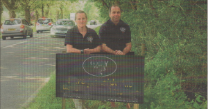 MIDSUMMER MVSTERY: Karen Goody and Peter Mccabe with their damaged sign for Goody Ales