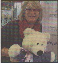 LUCKY WINNER: Anne Davies with her teddy prize from raffle