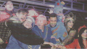 Members of the cast of Aladdin help turn on the lights