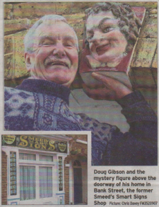 Doug Gibson and the mystery figure above the doorway of his home in Bank Street, the former Smeed's Smart Signs Shop