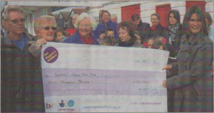 Pier Trust chairman Doreen Stone, in blue coat, with presenter Sarah Saunders and supporters