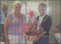 CELEBRATIONS: Treasurer Beryl Funnell presents flowers to the Lord Mayor