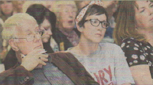 Vicki Radford listens to the-answer to her question