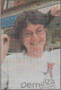 BEFORE: Demelza charity shop manager Sue Smy with her soon-to-be-gone hair