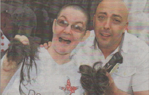 Demeiza shop manager Sue Smy has her head shaved for charity by Michael Monks from The Cube