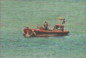 Two people were rescued after getting into difficulty in their kayaks on Saturday
