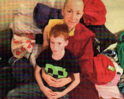FUNDRAISING: Emma Slade and her son Oscar, 8, with sleeping bags
