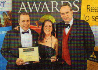 PROUD: Peter McCabe and Karen Goody of Goody Ales with sponsor Richard Cripps of Rix and Kay Solicitors